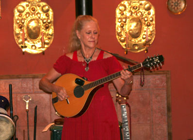 Barbara playing bouzouki
